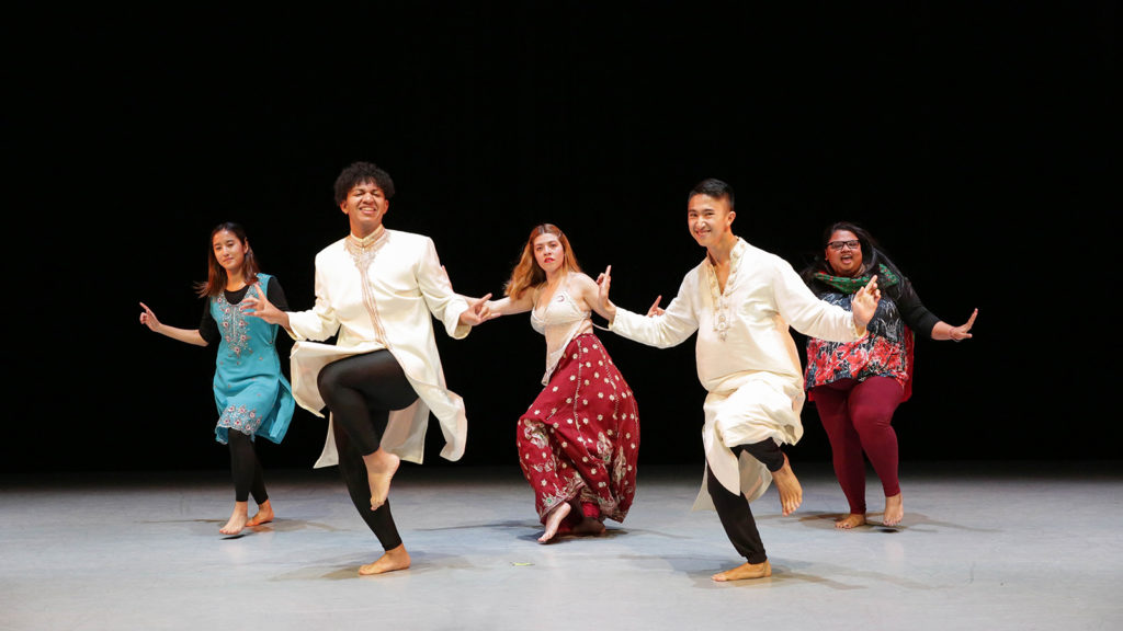 five dancers perform a Bollywood routine